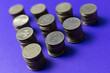 Leinwandbild Motiv Stack Of Coins On Table