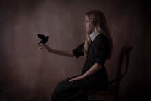 Gothic Girl Holding A Crow