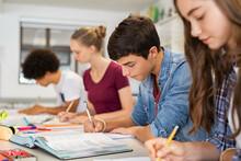 High School Students Doing Exam In Classroom