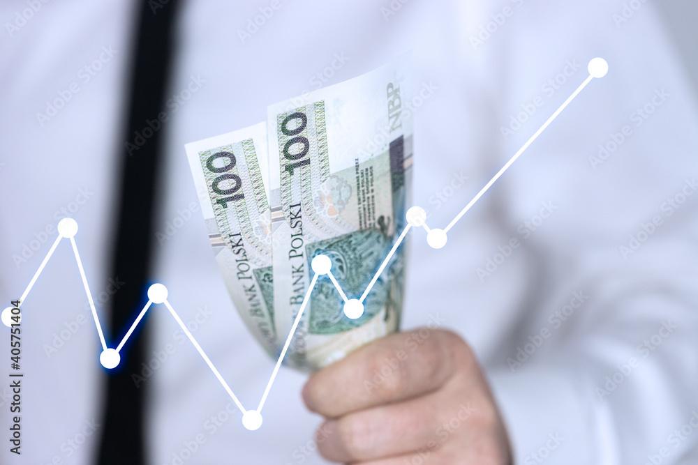 Fototapeta Gotówka w dłoni, polskie pieniądze, 100 złotych