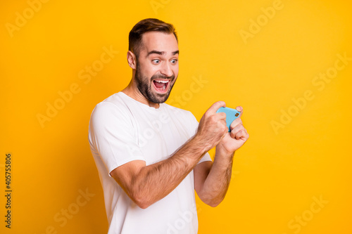 Profile portrait of impressed guy shoot telephone wear white t-shirt isolated on Fototapet