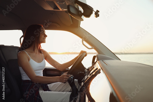 Young woman in car on road trip