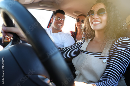 Happy friends together in car on road trip