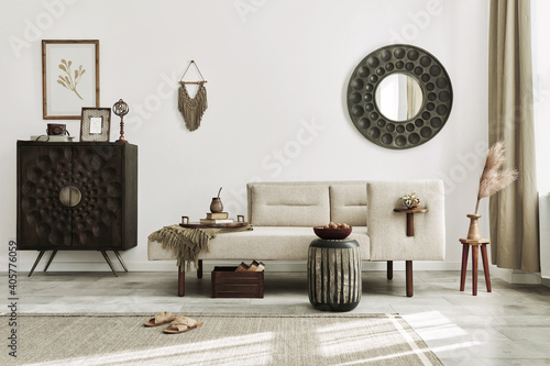 Modern ethnic living room interior with design chaise lounge, round mirror, furniture, carpet, decoration, stool and elegant personal accessories Fototapeta