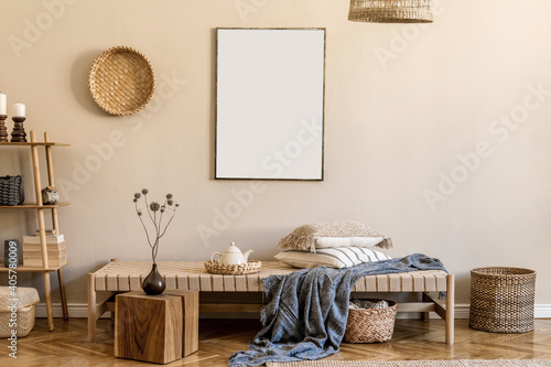 Modern composition of living room with design chaise longue, mock up painting, rattan decoration, wooden cube, pillows, carpet and elegant personal accessories. Stylish oriental concpet of home decor.