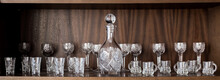 Crystal Set Of Different Glasses On The Shelf