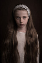 Intense Studio Portrait Of A Girl In White With Long Hair With Ribbon In Classic Painterly Style