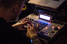 Beatmaker Producing Some Beats With A Drum Machine In His Home Studio