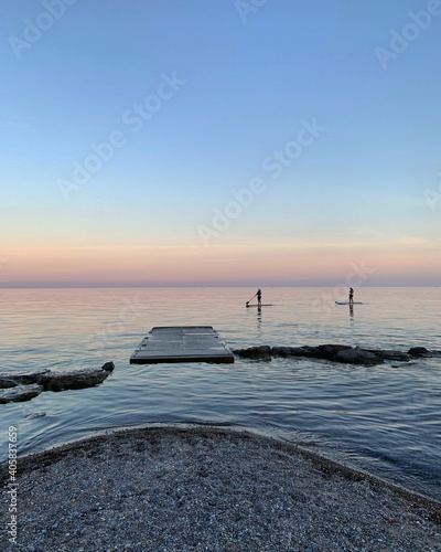 Fototapeta premium Scenic View Of Sea Against Sky During Sunset