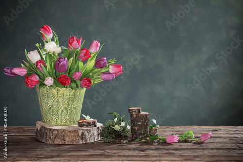 natural decoration with spring flowers on wooden table