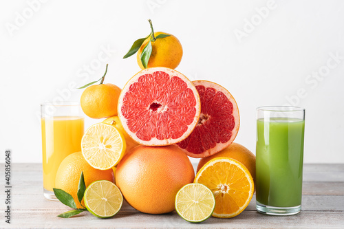 Fotografering Creative composition of slices citrus fruit and glasses of juice