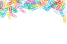 Close-up Of Multi-colored Paper Clips On A White Background. Place For Your Text. Business And Educate Concept.