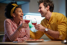 Delightful Mixed Couple Relaxing And Drinking Wine Together