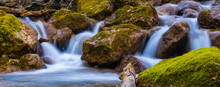 Small Waterfall On The Rushing Mountain River