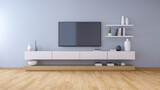 White Tv Cabinet  And Light Blue Wall On Hardwood Floor At Home