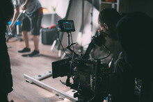 Director Of Photography With A Camera In His Hands On The Set.
