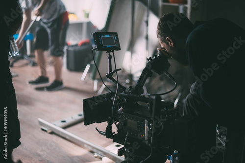 Director of photography with a camera in his hands on the set. Fototapet