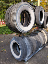 Collection Of Retro Vehicle Whitewall Tires Outdoors