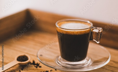 Obraz Close-up Of Coffee Cup On Table - fototapety do salonu