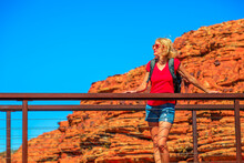 Tourist Caucasian Woman On Cotteril's Bridge Who Crosses A Deep Crevice Into Kings Canyon In Watarrka National Park. Outback Red Center, Northern Territory, Australia.