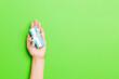 Leinwandbild Motiv Cropped Hand Holding Gift Against Colored Background