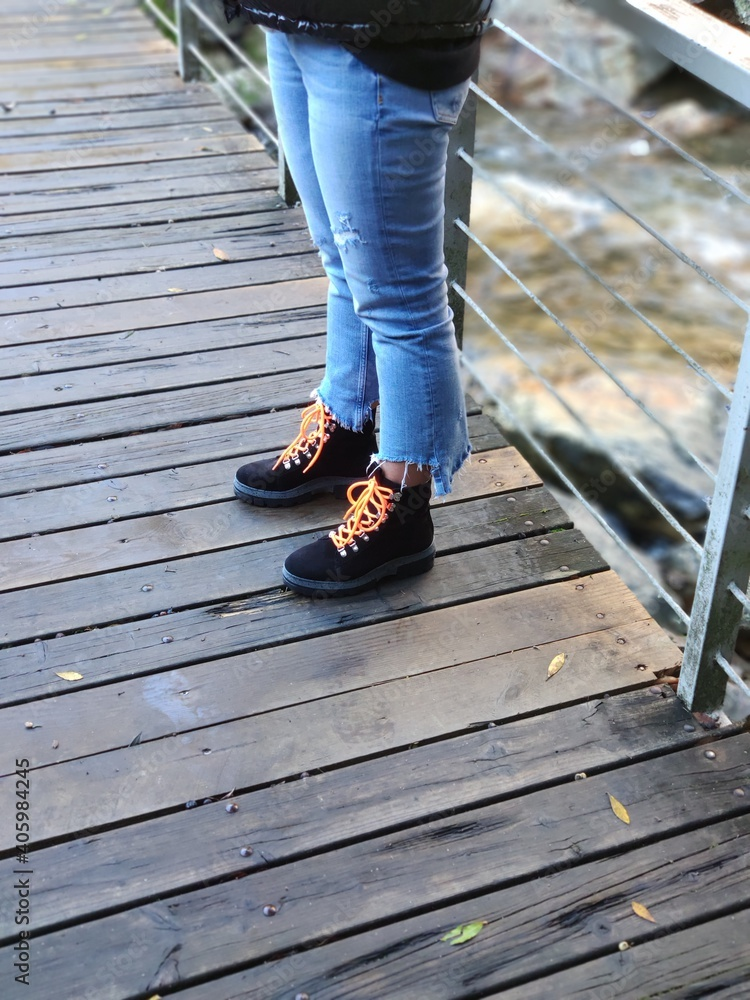 Fototapeta Low Section Of Woman Standing On Footbridge - obraz na płótnie