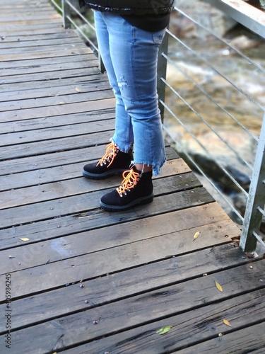 Fototapeta Low Section Of Woman Standing On Footbridge obraz na płótnie