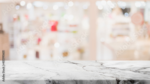 Empty white marble stone table top and blur glass window interior shopping mall banner mock up abstract background - can used for display or montage your products.