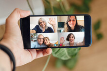 Multigeneration People Having Video Call With Mobile Phone During Lockdown Isolation - Social Distance Concept