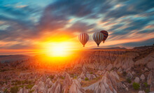 Hot Air Balloon Flying Over Rock Landscape At Cappadocia - Goreme, Turkey