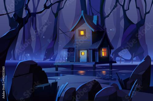 Fototapeta Wooden mystic stilt house on swamp in night forest