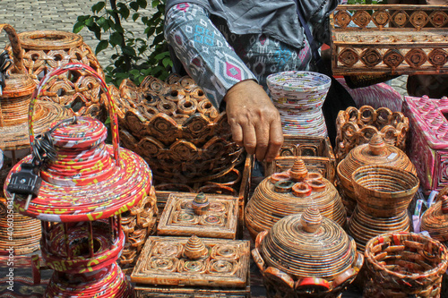 Midsection Of Woman Selling Antiques