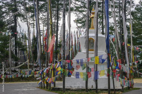 Buddhist chorten or stupa with traditional prayer flags and banners at a pass in Fototapeta