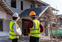 Engineer Recommend House Construction To Supervisor Supervisors At Construction Site. House Builder Concept.