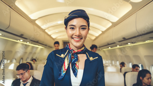 Obraz na plátně Cabin crew or air hostess working in airplane