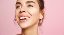 Close Up Of Happy Smiling Woman Face With White Teeth, Nude Lip-gloss And Natural No-makeup Look, Showing Clean Hydrated Skin Without Blemishes, Standing On Pink Background