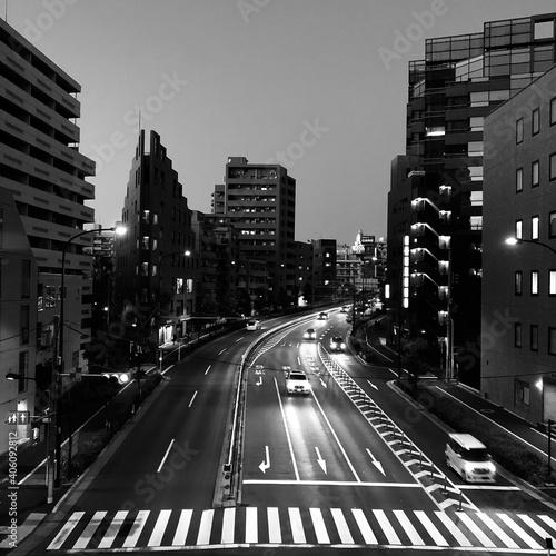 Fototapeta City Street And Buildings Against Clear Sky