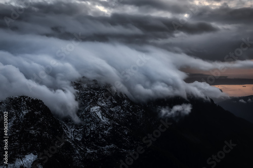Aerial view of Canadian Mountain Landscape. Taken near Vancouver, British Columbia, Canada. Dramatic Sunset Art Render