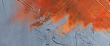 Orange Paint Smeared Across A Rough, Uneven Wall