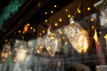 Decorative Glass Bulbs On A Showcase With Bokeh And Shallow Depth Of Field