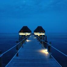 Pier Over Sea Against Blue Sky Ar Night