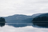 Scenic View Of Lake By Mountains Against Sky - 406186279