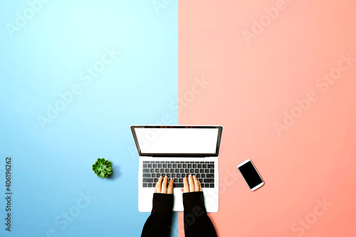Obraz na plátně Person using a laptop computer from above