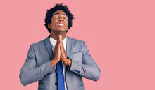 Handsome African American Man With Afro Hair Wearing Business Jacket Begging And Praying With Hands Together With Hope Expression On Face Very Emotional And Worried. Begging.