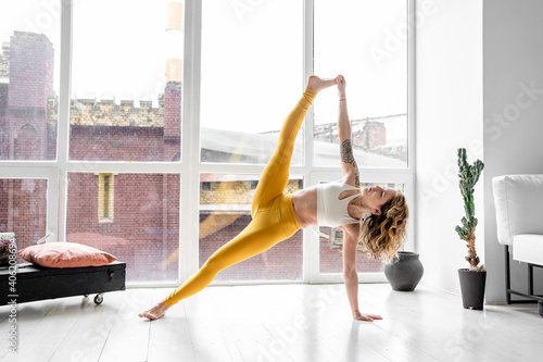 Obraz Beautiful Woman Performing Yoga At Home - fototapety do salonu