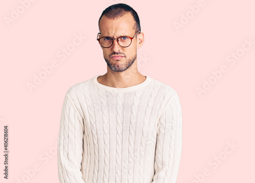 Fotografie, Obraz Young handsome man wearing casual clothes and glasses skeptic and nervous, frowning upset because of problem