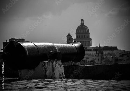 Vászonkép Cannon On Building Terrace Against Sky