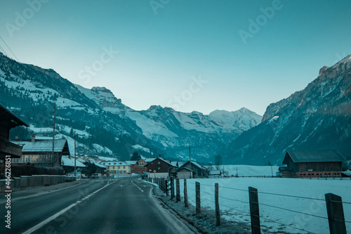 Road leading to Kandersteg in early morning in cold temperatures, majestic mountain panorama over the road Tapéta, Fotótapéta