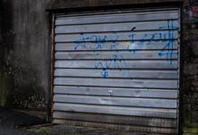 Old Garage Door Vandalised By Graffiti