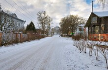 Road Amidst Buildings Against Sky During Winter